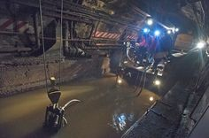 """The Secret Lives of NYC Mega-Projects, Revealed By One Photographer- Rush to repair the subway system, including this shot of a """"pump train"""" removing ocean water from the L Train tunnel."""