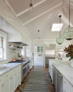 Creative accents, including orb lighting, complement interesting architectural details like a vaulted ceiling and skylight. Creative accents, including orb lighting, complement interesting architectural details like a vaulted ceiling and skylight. Kitchen Decor, Kitchen With High Ceilings, Home Decor Kitchen, Bohemian Kitchen, Vaulted Ceiling Kitchen, Kitchen, Modern White Kitchen Cabinets, Kitchen Remodel, Contemporary Kitchen