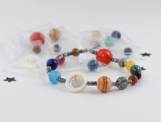 ***********Solar System Bracelet Making Kit***********  (((((This is a bracelet making kit. You will not receive the finished product. You will be receiving everything you need to make this bracelet yourself, along with the instructions. No tools needed!)))))  © ALL RIGHTS RESERVED. NOT FOR RESALE!! Only use for personal use.  Take a trip to the outer space and gaze at the stars with our beautiful planet jewelry!!!! Our beautiful planet jewelry were made amoungst the stars on distant…