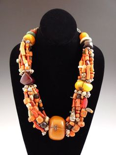 Africa | Old Berber necklace | Amber, coral, shell, amzonite, coral, agate and a variety of other beads.