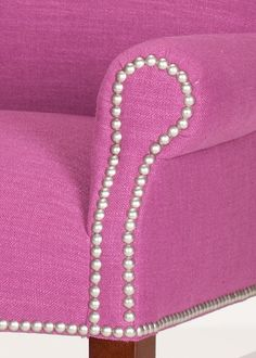 Nailhead trim used to outline a rolled arm. These nickel nails make a contrast to the purple fabric. Parsons Chairs, Purple Fabric, Wing Chair, Nailhead Trim, Outline, Dining Chairs, Contrast, Wings, Arm