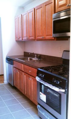 Great working space in this newly renovated kitchen with wood cabinets and stainless steel appliances.