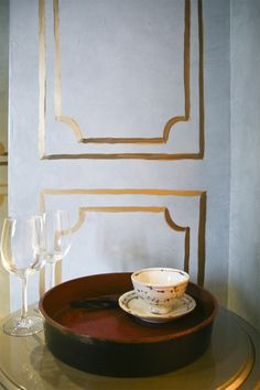 Gold paint drawn on the walls instead of molding...great idea!