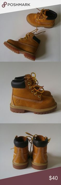"Timberland 6"" Premium Waterproof Toddler Boots Timberland kid's boots # 12809 Boy's toddler size 6. Waterproof leather upper with a padded collar for comfort.  Rubber sole with lugged traction pattern.  Overall good condition- some wear at toes, inner side of left shoe, bottom and inner sole are barely worn. See all photos for condition!  *I offer 10% off bundles of 2+ items!* Timberland Shoes Boots"