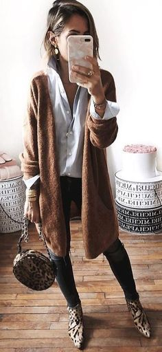 #spring #outfits woman wearing brown fur long coat in the white wall paint room. Pic by @i__am_fashion