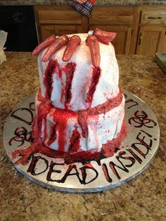 Zombie cake! Mixed strawberry syrup, red food coloring, and buttercream frosting to get the gory guts look. Delicious and so gross looking!