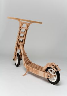 I was inspired by plywood models. The body is made from plywood and is connected by ribs without using any mechanical joints, including the main articulation of handlebar fork.U této koloběžky jsem se inspiroval překližkovými modely. Trup koloběžky je t… Wooden Scooter, Wooden Bicycle, Wood Bike, Cnc Projects, Woodworking Projects, Arte Pallet, Kids Bike, Designer Toys, Wood Toys