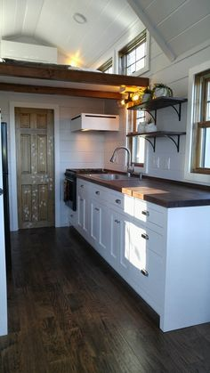 A gorgeous farmhouse-style tiny home with a traditional tiny house layout! Available for sale in Eastford, Connecticut! Tiny House Listings, Tiny House Plans, Tiny House On Wheels, Tiny House Layout, Tiny House Design, Diy Kitchen, Kitchen Design, Kitchen Tools, Kitchen Gadgets