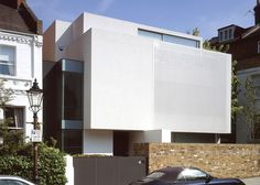 Stretched fabric hides the windows and balconies of an artist's Hampstead home.