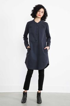 Heavyweight organic cotton twill artist's smock – gathers at the shoulders add volume – extended yoke and center back gathers – Hidden side pockets – Collarless with six button closure – a versatile shade of blue – Quantity produced: 8 in mood indigo – Made in Seattle, U.S.A