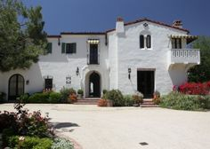 """Front Facade of """"El Sueno"""" by Kevin A. Clark Inc. Residential Architecture.  Photo credit: Architectural Digest - Spanish Colonial Revival estate."""