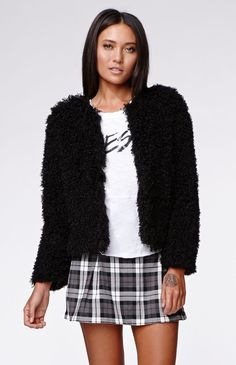 """The women'sCurly Fur Coat by Kendall & Kylie for PacSun and PacSun.com has a super cute curly faux fur construction and cropped cut. The jacket has a soft interior for the most comfortable fit. Wear this stylish jacket over your dresses, or with your denim and tops!20"""" length21"""" sleeve lengthMeasured from a size smallModel is wearing a smallHer measurements: Height: 5'9"""" Bust: 32"""" Waist: 25"""" Hips: 35""""100% polyesterDry clean onlyImported"""