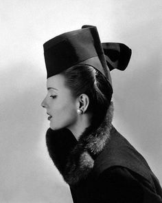 July 1942 | Italian-Canadian model Bettina Bolegard is wearing a green felt hat with grosgrain ribbon by Lilly Daché.  Image by © Condé Nast Archive/Corbis