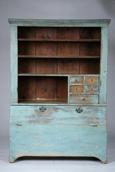 American Pine Cupboard...19th. century. One-piece cupboard with shelves and small drawers in the upper section & divided bins in the lower section. Retains old, grungy, dry blue paint.