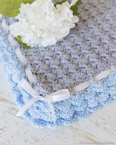Crochet Baby Blanket with scalloped edging, trimmed with a ribbon and bow.  Gray and blue baby blanket.