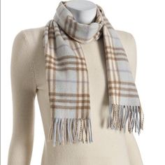 Burberry scarf 100% cashmere Beautiful and ridiculously soft baby blue Burberry scarf. Rare to find. Made from 100% cashmere and in great condition and no stains. Tiny hole which you can see in last pic but can't notice while wearing. Looks amazing. Burberry Accessories Scarves & Wraps