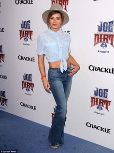 Star attraction: Model Brittany Brousseau posed for cameras while clad in jeans and tied u...