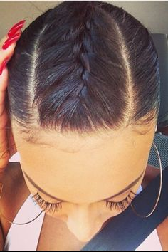 Braided fringe into a tight low bun