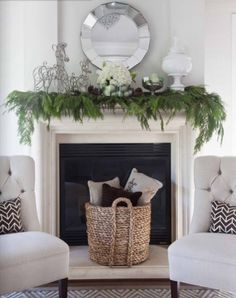 Christmas mantel love the chairs