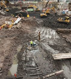 Associated PressArcheologists, center, take measurements of the wood hull of a 32-foot-long (9.75 meters) 18th century boat at the World Trade Center site, Thursday, July 15, 2010 in New York.