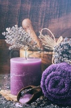 Lavender spa setting with candle and towels by Andrea A. Elisabeth