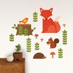 I love the idea of a cute woodland creature themed nursery | Fabric wall decal set by Petit Collage, click through for more details