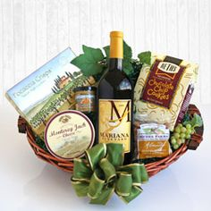 VINTNERS WELCOME ~  Open their world to the #wine country with our vintner's choice #gift basket. A hearty red #wine surrounded by tasting essentials such as cheese, crackers, mustard and almonds. Sweet treats for dessert include a specialty chocolate and chocolate chip cookies. To Order: www.BountifulGrapes.com