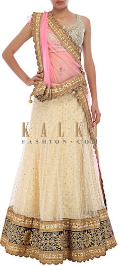 Buy Online from the link below. We ship worldwide (Free Shipping over US$100) http://www.kalkifashion.com/off-white-lehenga-embellished-in-thread-embroidery-and-kundan-only-on-kalki.html