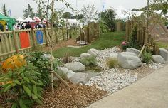 natural playscapes ideas | Landscaping within playground design