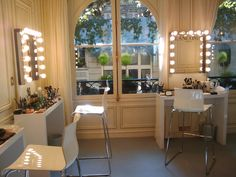 "gross see all the makeup laying about? like the chairs a lot, silver touches are nice, mirror could be bigger but its good the lights go all the way around, is it cheesy having the logo on the mirror?? table height is way off look how high the chair is to the table. Thought this was a good ""not good"" example photo"