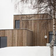 This family home by Danish practiceNorm Architectsis filled with cosy nooks and opening living areas with generous windows to give views out over picturesque woodland and a lake set around anhour's drive north of Oslo.