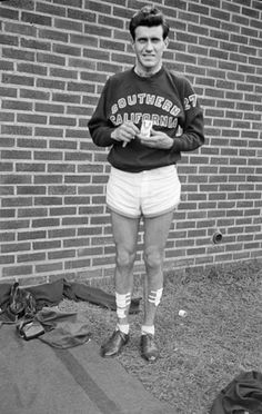 With a cracked rib and puncture wounds to both legs and one foot, Louis Zamperini celebrates his record-setting NCAA Championship victory. His record held for 19 years. Jack O'connell, Great Books, My Books, Preppy Men, Book Sites, College Fun, Olympians, Nonfiction Books, Film