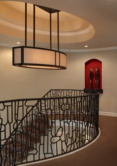 Unique custom designed metal light fixture and stair railing. AMW Design Studio Amy Weinstein - Birmingham, MI