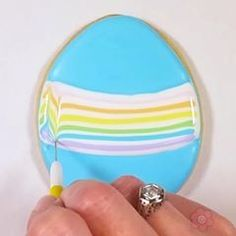 Create a stunning rainbow Easter egg cookie using an easy, but impressive, marbling technique. Add a few piped details and loops to create a whimsical look. Plus, today is the LAST DAY to SAVE 10% on ALL Easter cutters and stencils with coupon code EASTER10 on www.flourbobakery.com. #Eastercookies #Easter #Easteregg #Rainbow #DecoratedCookies #cookievideo #cookiedecorating #cookiesofinstagram