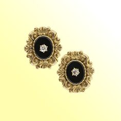 Antique European Onyx and Diamond Earrings: Absolutely lovely Victorian era earrings crafted in rare 20K ('800') yellow gold rendered in a timeless neo-classical design consisting of half shells and decorative swirls. The oval onyx center supports a .10 ct. old-mine cut diamond in a six-prong setting. The backs are all original and stamped with assay and maker's marks. A rare find.