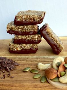 For the ultimate afternoon pick-me-up you can't go past the combination of nuts, seeds and chocolate in these Choc Dipped Seed & Nut Bars. Healthy Mummy Recipes, Healthy Sweets, Healthy Baking, Raw Food Recipes, Sweet Recipes, Baking Recipes, Healthy Snacks, Snack Recipes, Healthy Slice