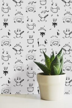 Temporary wallpaper allows your kids to complete the critters with crayons, markers, or pencils -- either their animal bodies or kid-designed clothing. Comes off without damaging the surface beneath it.