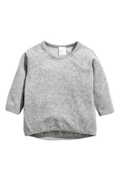 BABY EXCLUSIVE/CONSCIOUS. Top in soft organic cotton velour with long raglan sleeves, press-studs on one shoulder (size 0-3 months with press-studs on both
