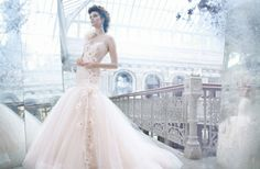 Just a hint of pink and a seriously glam mermaid shape make for one killer #wedding dress.