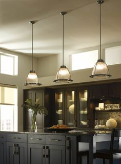 Focus pendant lights on a specific work area, such as over a sink or island. One small pendant may be sufficient for certain task applications. For larger spaces, consider placing pendants in a row at equal heights for a clean, contemporary look.