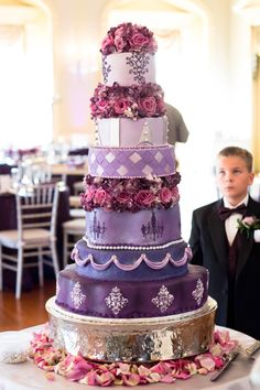 I love his expression!  Yes, It's ALL cake! Tall purple and lavender wedding cake