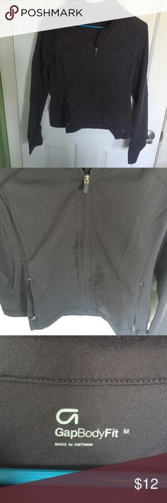 Gray gap body workout zip up Gray workout zip up jacket that unzips all the way. There are two smaller zippers in the front. Also has thumb loops! GAP Tops