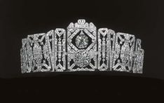 Art Deco tiara of Doreen, Lady Brabourne, 1925. A series of diamond-set geometric panels to the central old-cut pendant and quartrefoil cluster, which detaches to form a brooch.This tiara was worn to two Coronations, that of King George VI, 1937, and the coronation of Elizabeth II, 1953. Sold at Christie's in 19th June 2002, where it fetched £38,240. (Dowager Lady Brabourne died in the same explosion which killed Lord Mountbatten and their mutual grandson, Nicholas Knatchbull.)