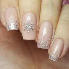 23 Latest Winter-Inspired Nail Art Ideas: #2. STUNNING SNOWFLAKE AND GLITTER NAILS; #nailart; #naildesign