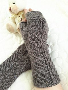 Knit PDF pattern knitting pattern fingerless gloves arm hand warmers pattern knit mitts pattern knitting instructions pdf instant download *****THIS IS A PATTERN ONLY, NOT A FINISHED PRODUCT*****  ****INSTANT DOWNLOAD**** once the payment is confirmed. Simple and enough quick to knit project.   Skills: knit, purl, make one, left/right twist, cable knitting, knit in round using magic loop method  Sizes: one size, adult S, M  Finished measurements: approximately 10 inches (27 cm) long Yarn...