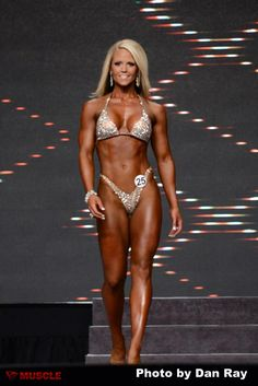 In case anyone left in the world still thinks lifting makes women manly. Nicole Wilkins, 2013 IFBB Olympia Champion.