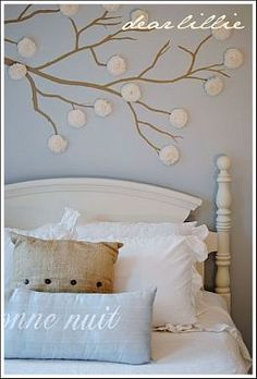 Paint a tree branch on the wall and add crepe paper flowers (includes directions making the flowers) --- Cheap Wall Decor Ideas for Decorating on a Budget