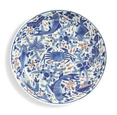 "A large underglaze blue and copper-red ""Fish"" dish. Qing Dynasty, Kangxi Period 