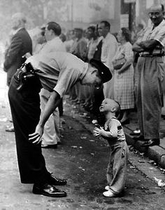 'Faith and Confidence' Photographed by William C. Beall 1958 Pulitzer - A policeman speaks to a young boy at a parade in Washington DC. The 2-year-old is trying to cross the street during the parade.