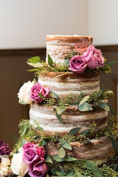 Rustic naked cake with pink flowers and greenery